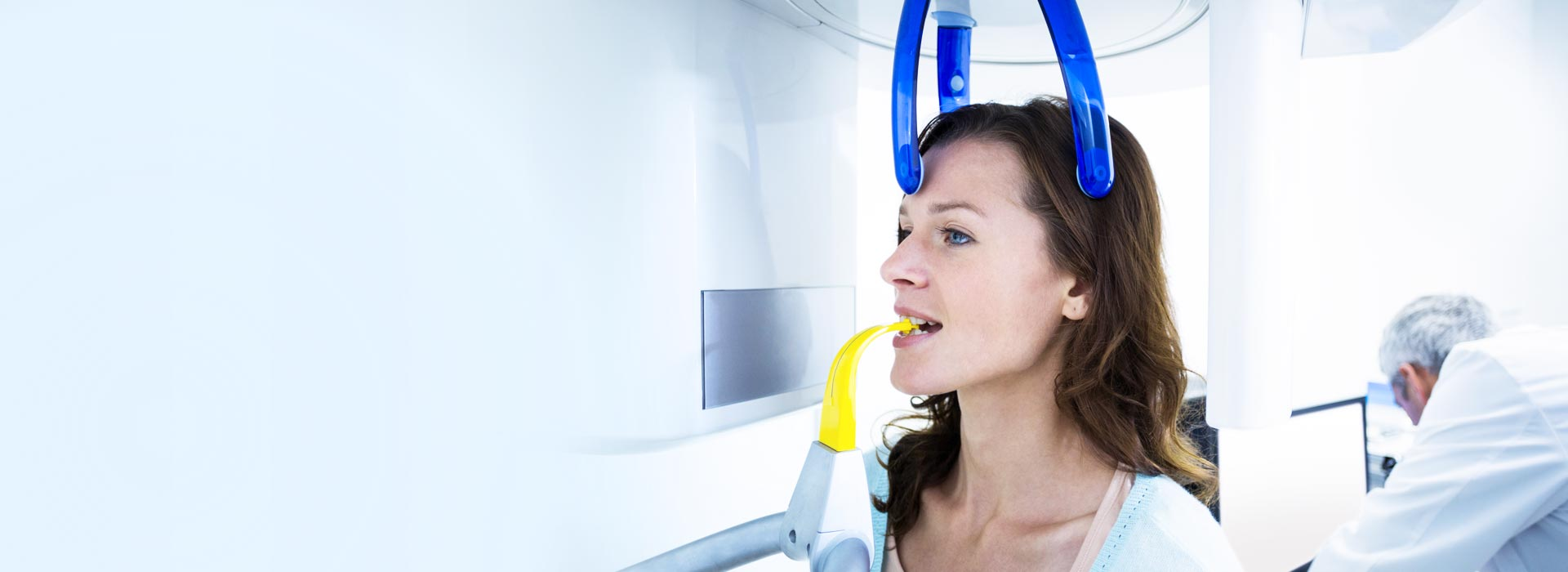 A woman is having dental x-ray