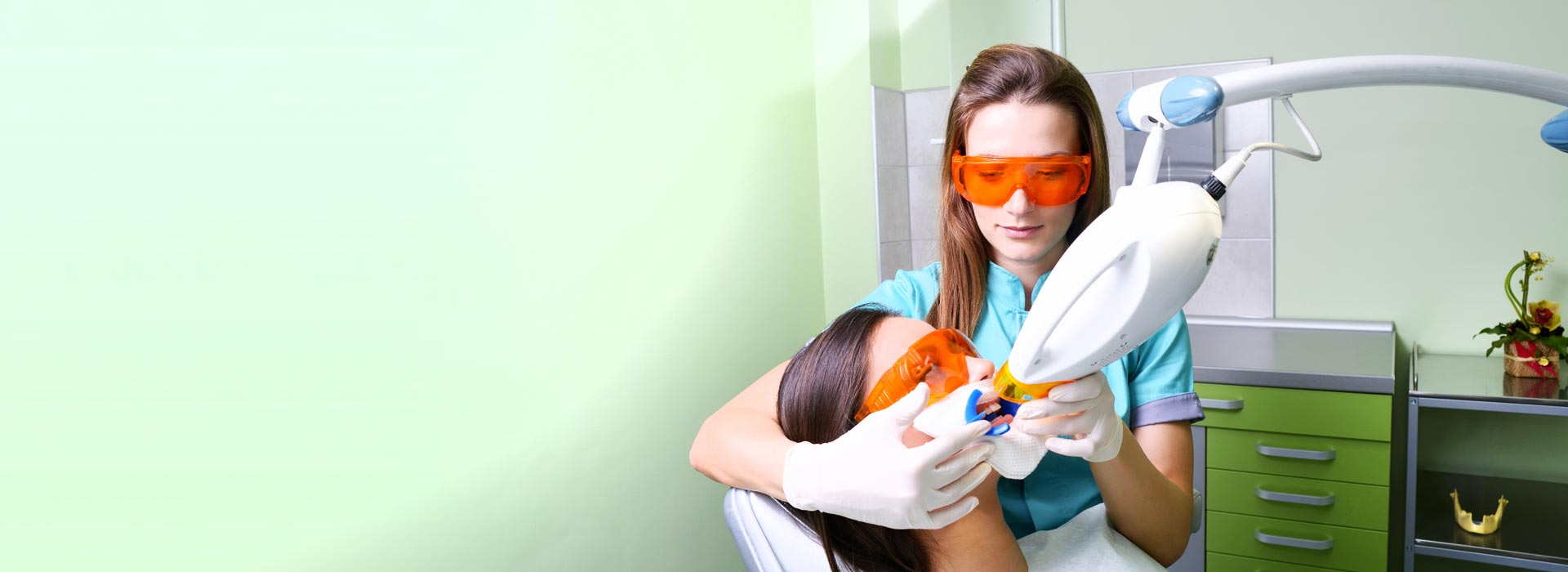 A woman is having treatment at the dental clinic