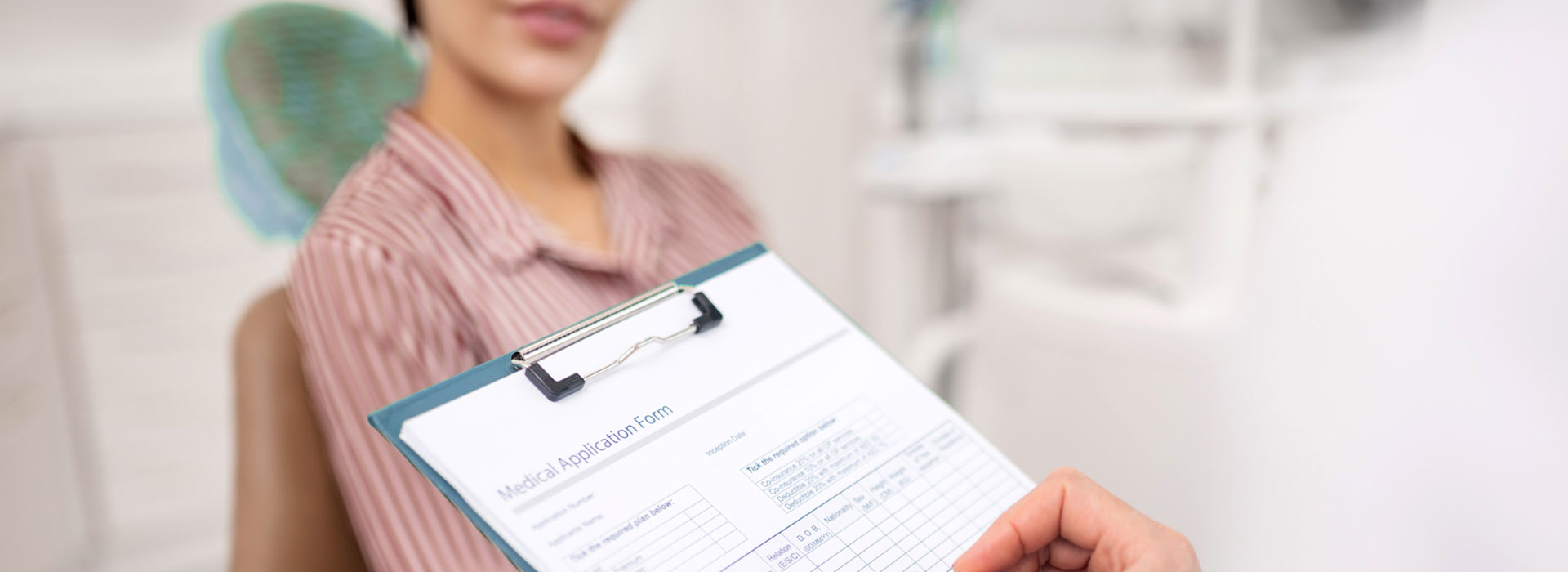 A dentist is filing patient form