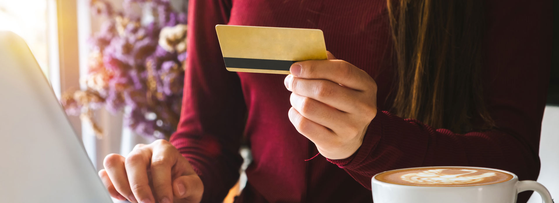 A woman is using her credit card for dental payments