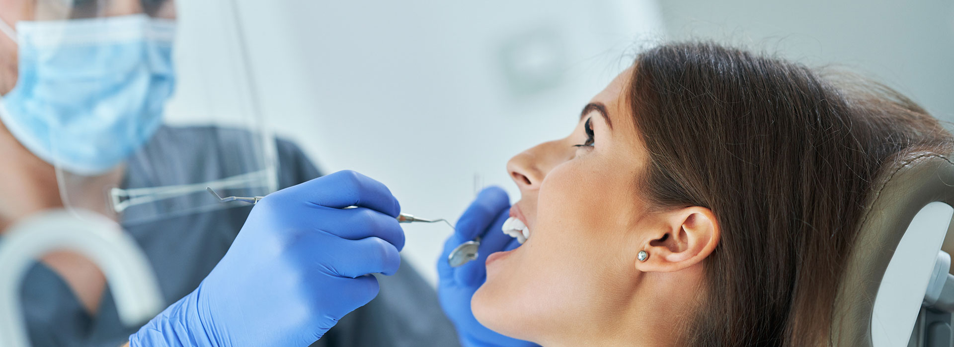 A beautiful woman is having clear aligner
