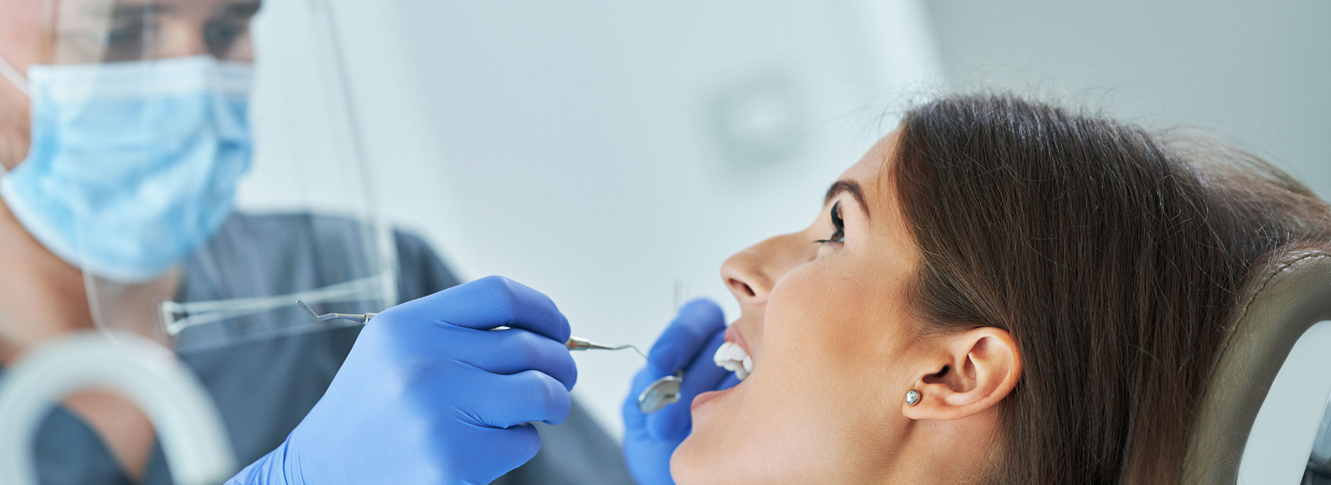 Woman is having a dental surgery