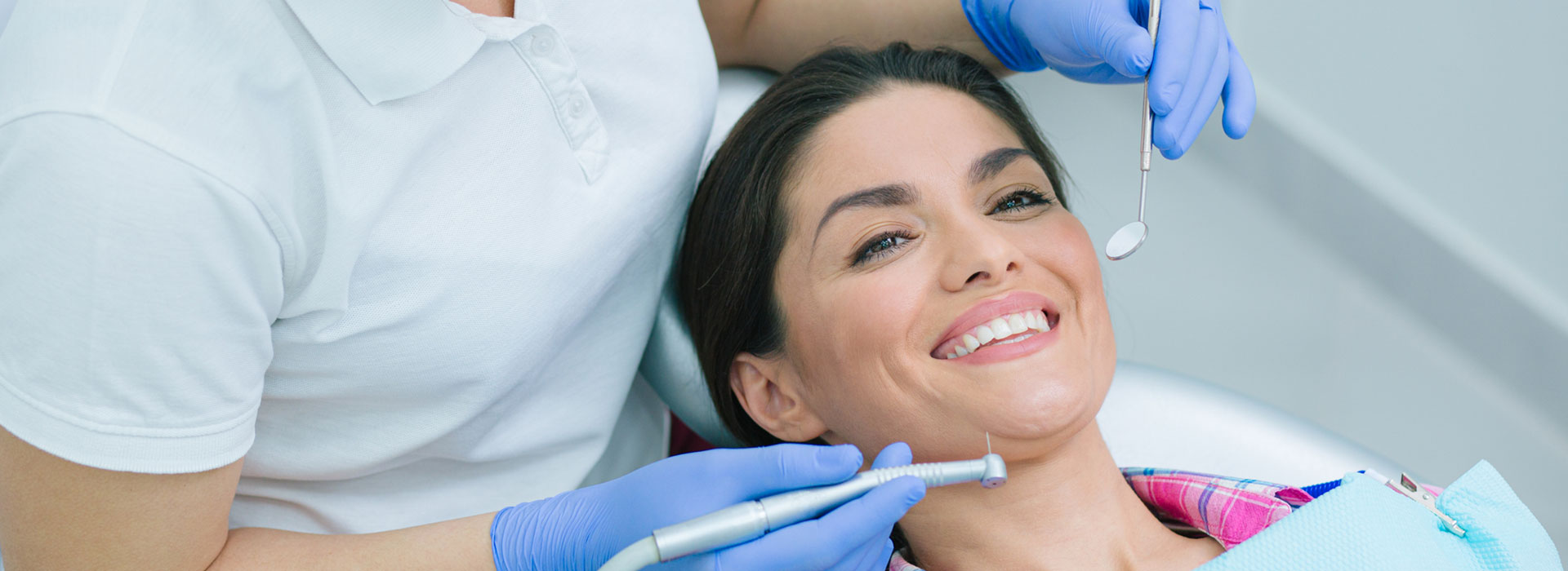 A beautiful woman is smiling at the dental