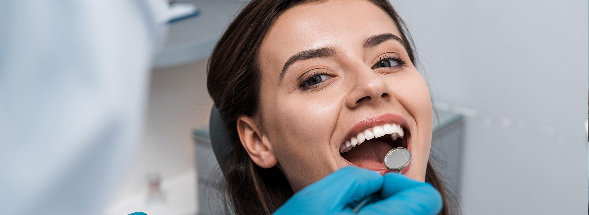 A beautiful woman is having dental checkup