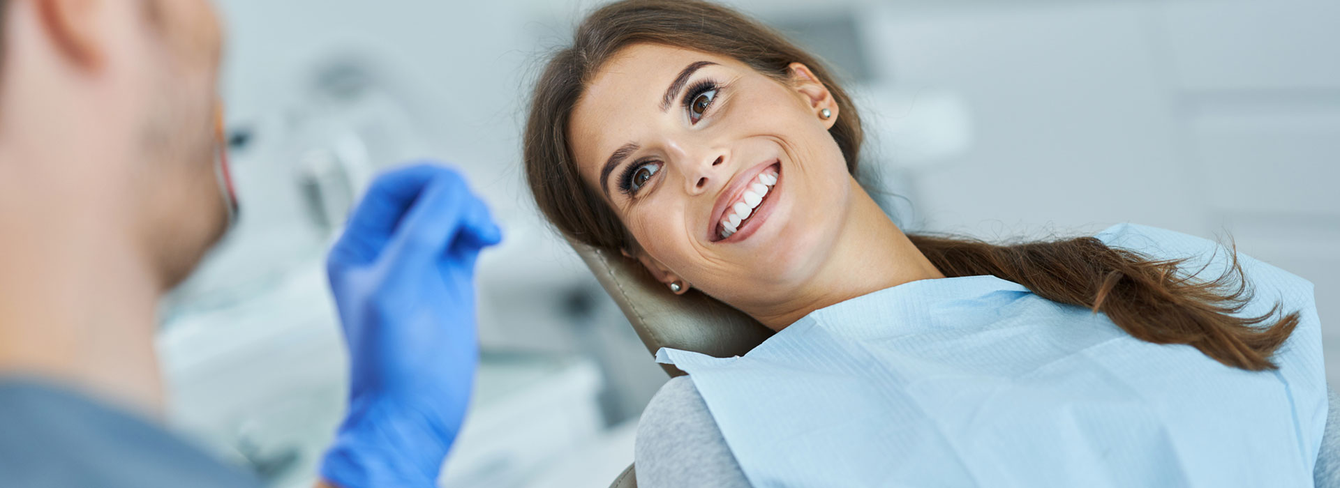 A beautiful woman is smiling after dental sealants