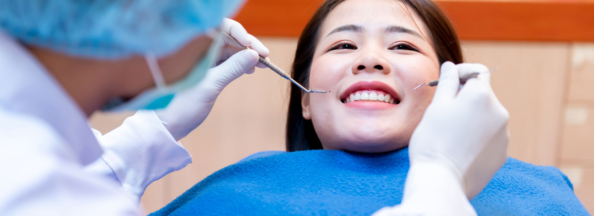 A beautiful woman is smiling after teeth whitening