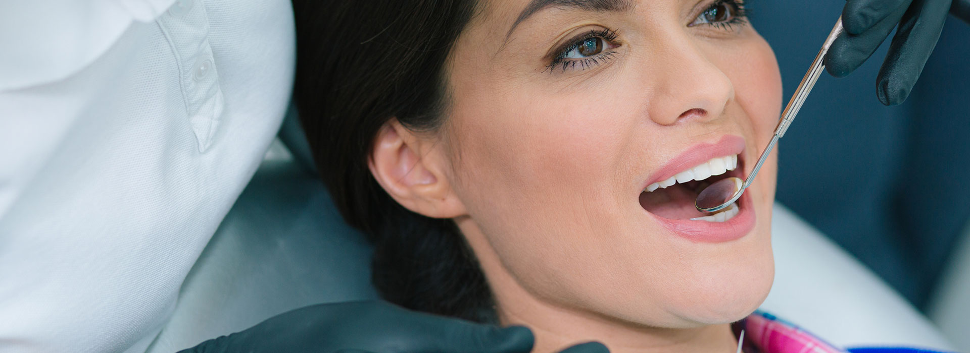 A beautiful woman is smiling after Silver diamine fluoride treatment