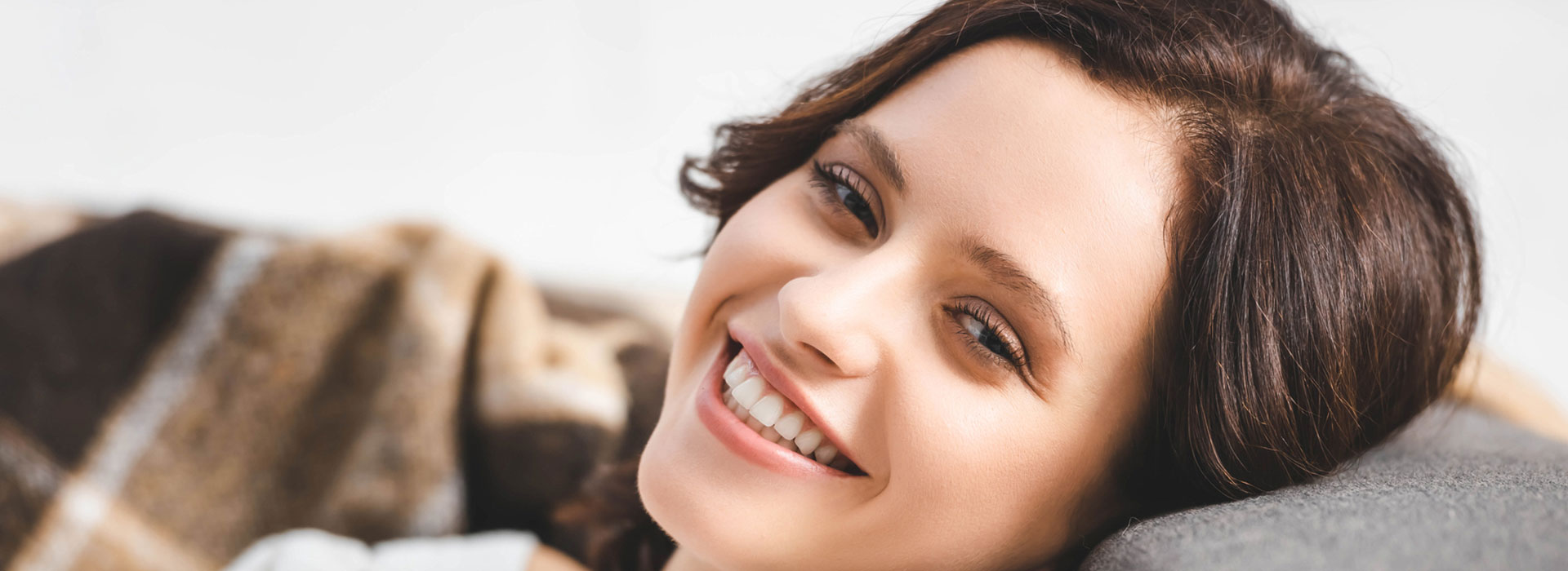 A beautiful woman is smiling after preventative dentistry